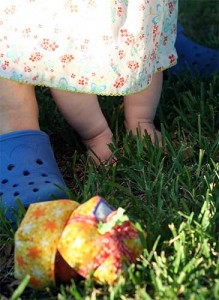 lil feet in the green grass